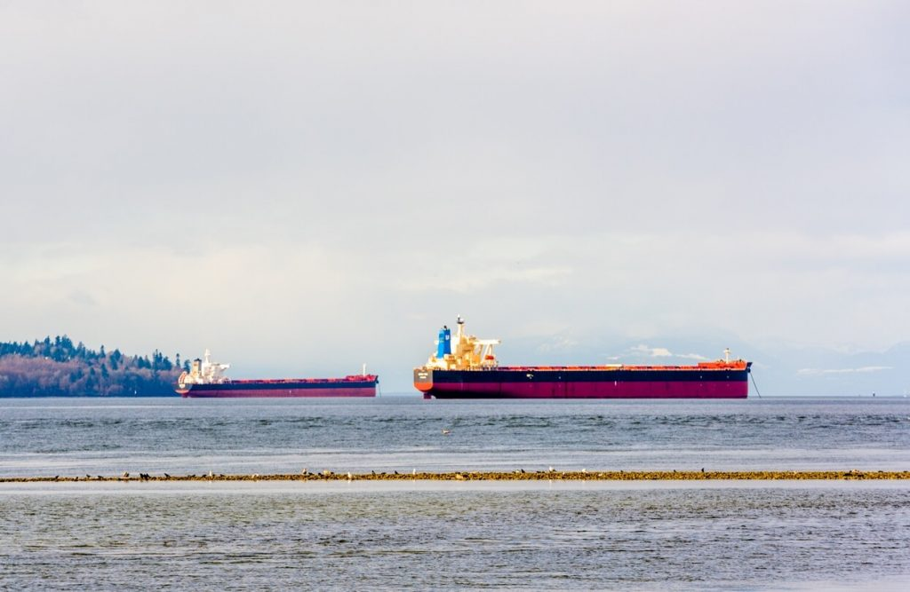 Commercial ships anchored in English Bay, Vancouver, BC.